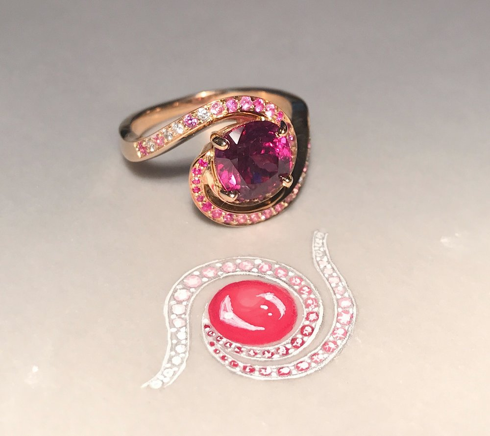 The garnet Galaxy ring pictured with the first rough working sketch.