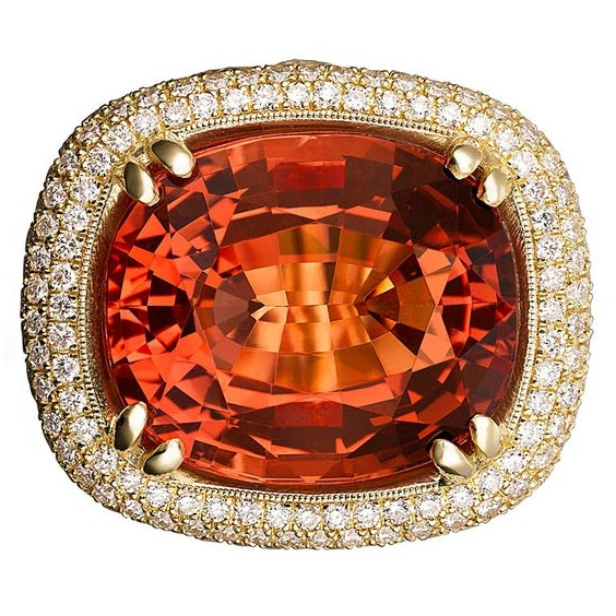 An impressive cushion cut Imperial topaz and diamond ring.