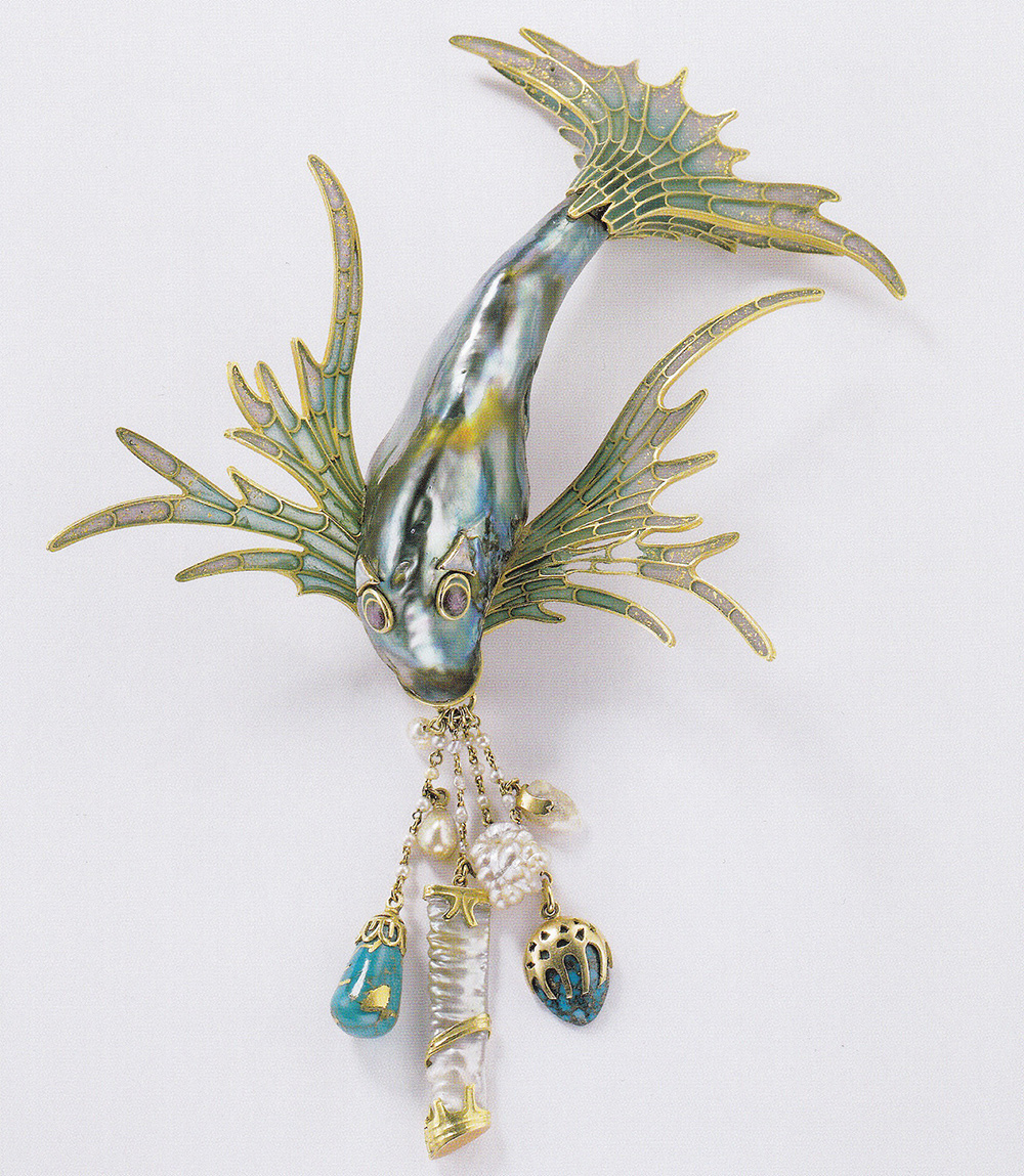 Abalone pearl and enamel fish brooch by Georges Fouquet.  Imperfectly shaped stones and humble materials such as enamel have been raised to masterpiece level.