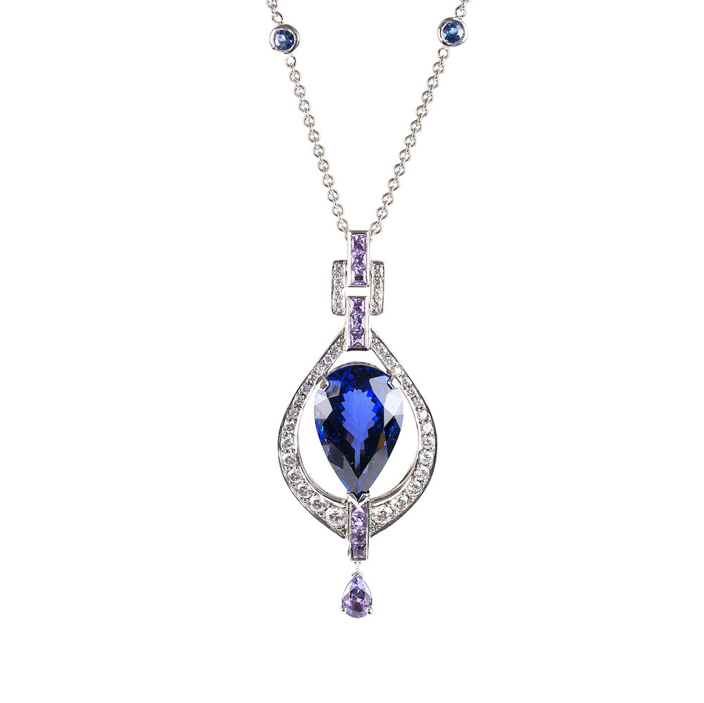 An Art Deco style pendant set with diamonds and lilac sapphires.