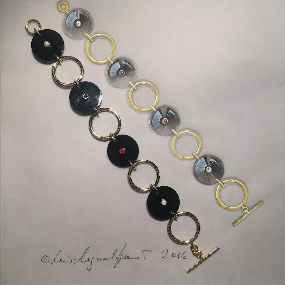 An onyx and gold bracelet with coloured stones.