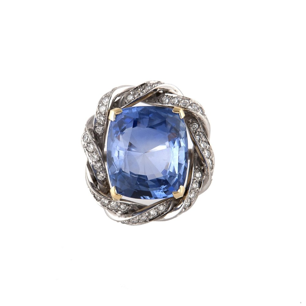 Top view of a Ceylon sapphire and diamond ring in a bespoke setting.