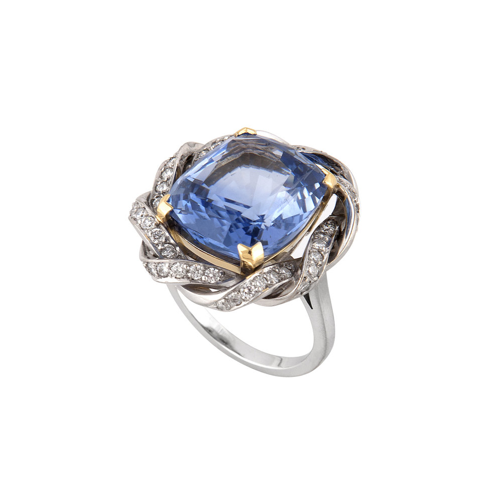 Three quarter view of a Ceylon sapphire and diamond ring in a bespoke setting.
