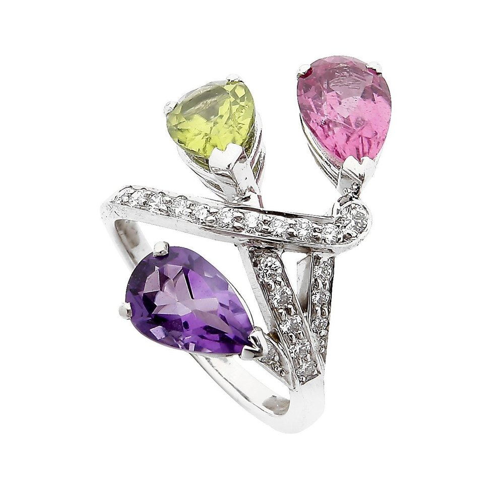 Bespoke asymmetrical ring in pink sapphire, amethyst and peridot, set in white gold and diamonds.