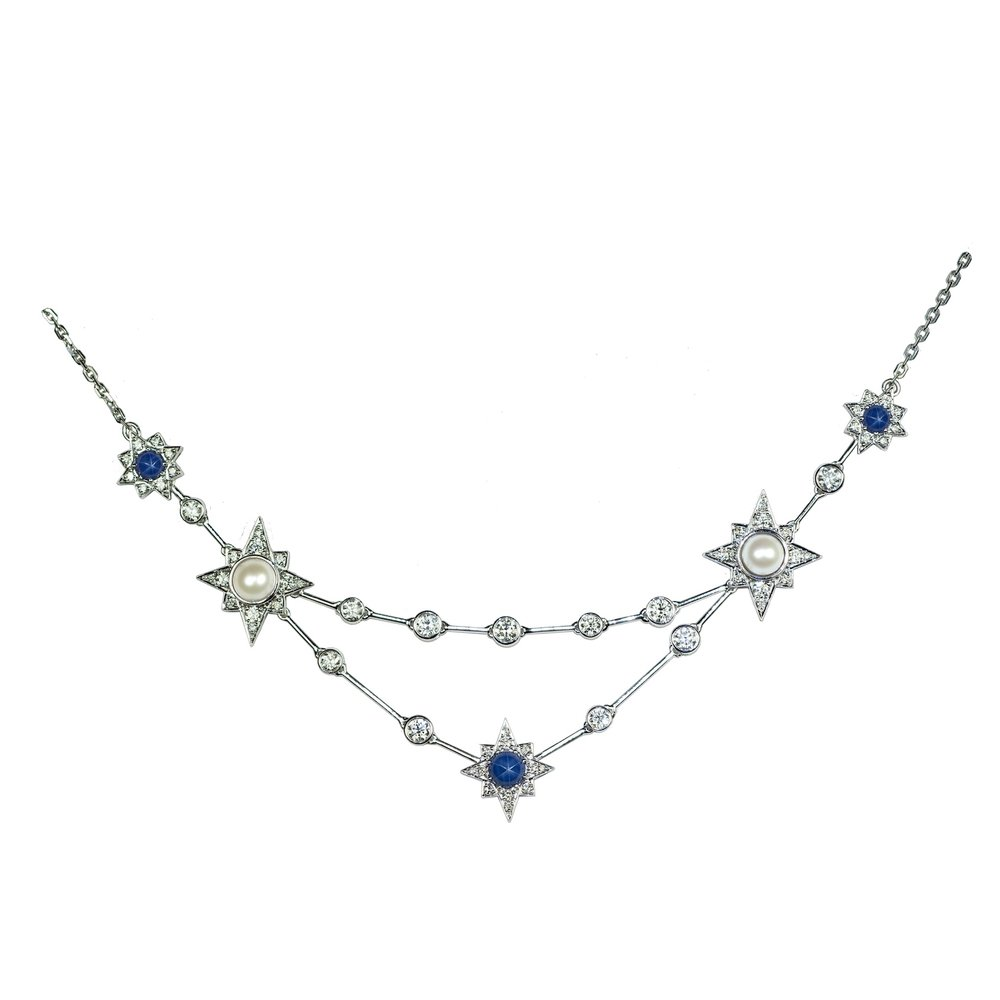 Bespoke Constellation necklace set with pearls, star sapphires and diamonds. Created as an 18th birthday present.