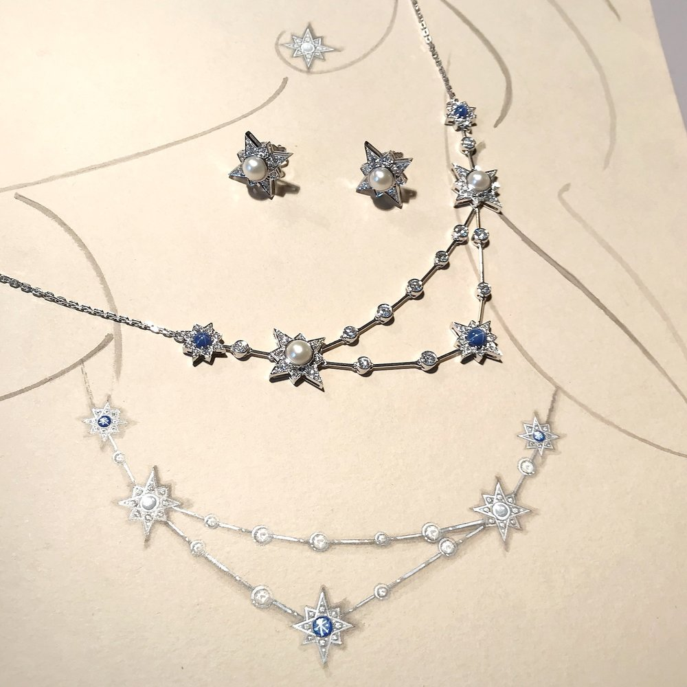 A snapshot of the Constellation necklace set with pearls, diamonds and star sapphires. It is shown with its working drawing in gouache and Chinese ink.