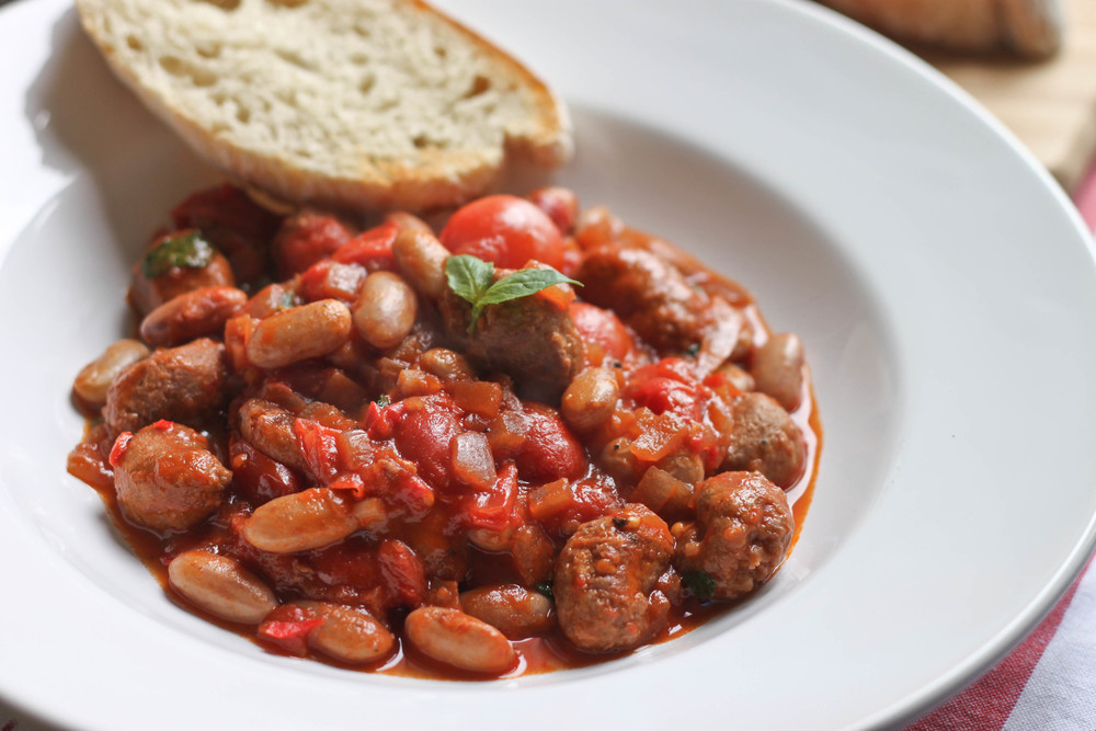 Sausage and berlotti bean stew recipe from  icanhascook.com . The recipe is not vegan but all you need to do is switch the sausage for a vegan one!