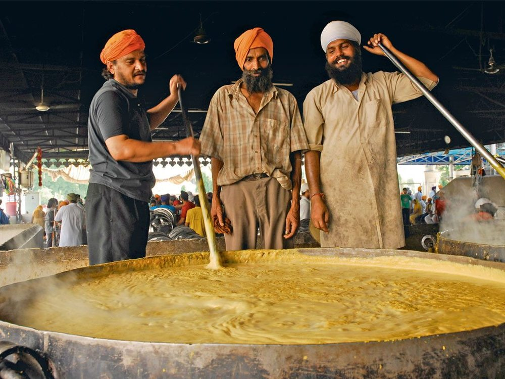 Guru Ka Langar, the community meal served at Amritsar's Golden Temple, feeds approximately 75,000 people every day. Photo: Kay Maeritz/Look/Dinodia