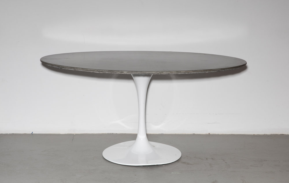 2_Patrick Cain Designs_Harvey Concrete Tulip Table_Cowhide.jpg