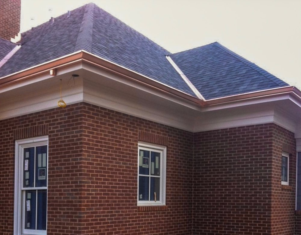 Copper box gutters and copper W valley, complement the installed CertainTeed Landmark Pro shingles.