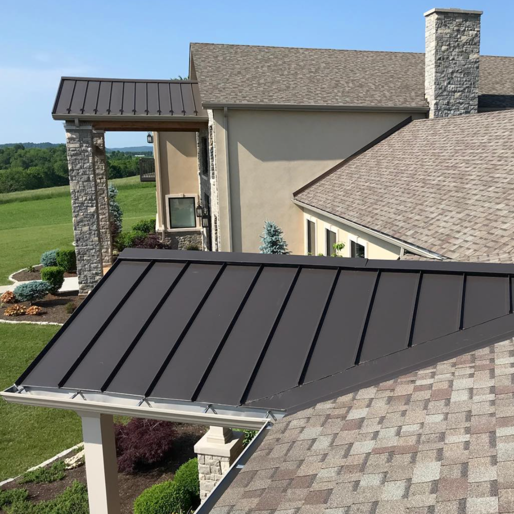 Drexel metal standing seam in medium bronze paired with Owens Corning Duration Driftwood