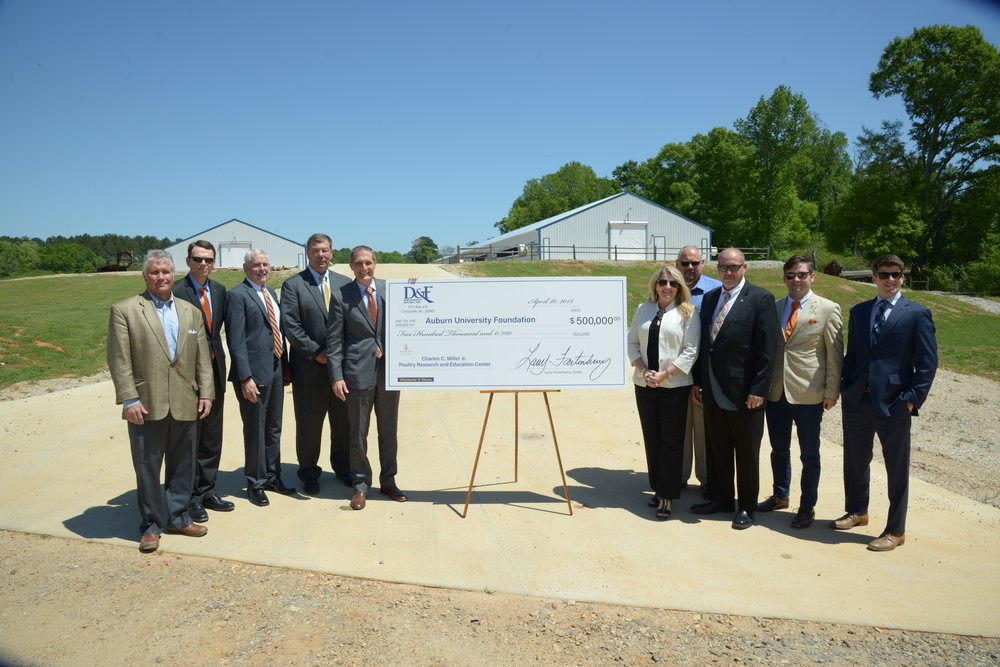Representatives of Auburn University, the College of Agriculture and the poultry industry celebrate a $500,000 gift from D&F Equipment Sales Inc. and the Fortenberry family to support the next phase of construction at Auburn's Charles C. Miller Jr. Poultry Research and Education Center in North Auburn. (Auburn University)