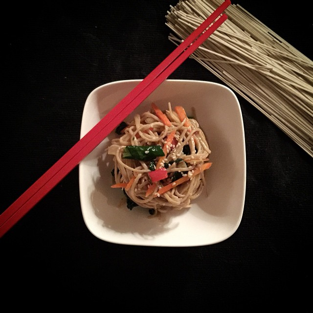 Tonight's dinner! Soba noodles in a sesame ginger shoyu sauce with kale, carrots and red peppers #vegan #chopsticks #soba #holla