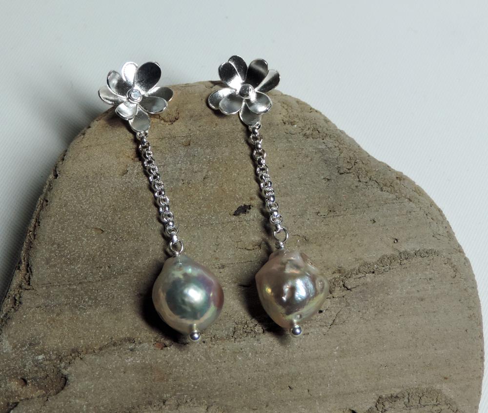 Sterling silver hydrangea flower studs with salt water baroque pearl drop earrings.