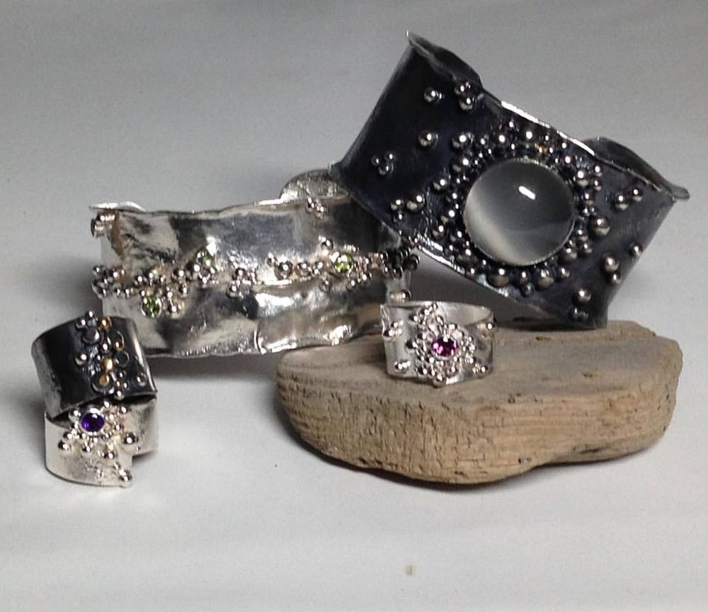 Reticulated silver bauble rings with amethyst, rhodolite garnet, and oxidized with 18k yellow gold. Reticulated silver cuff bracelets wave with 5 peridot gemstones and oxidized with large moonstone.