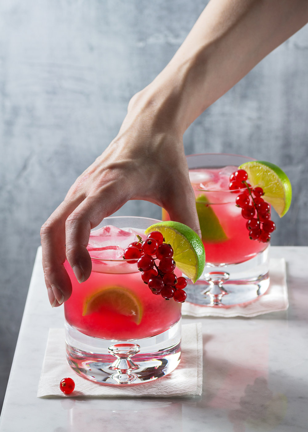 Reaching for a Red Currant Caipirinha
