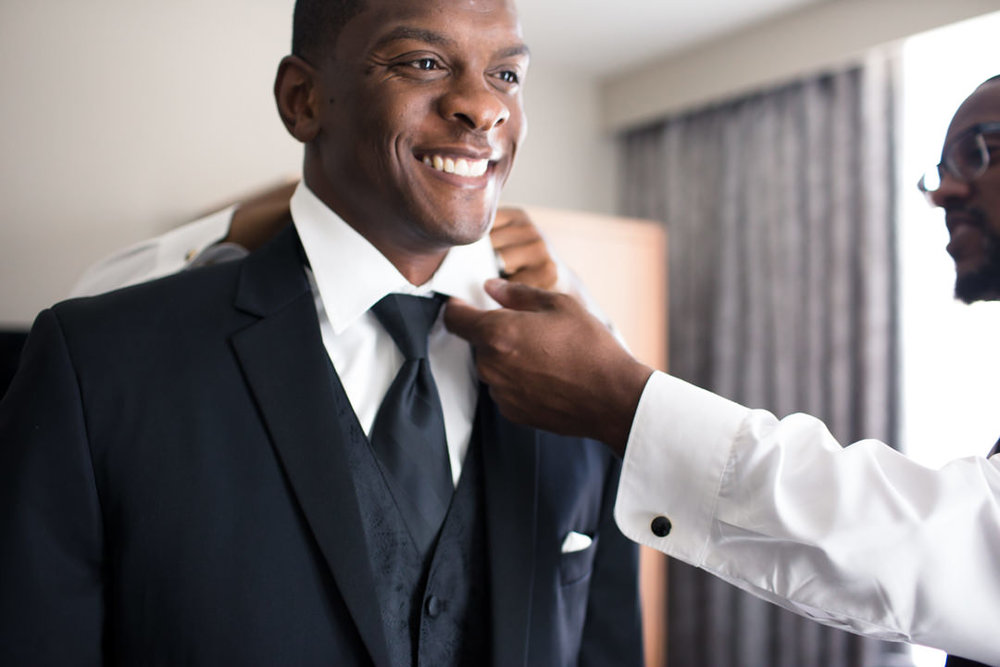 0003GROOM-SUIT-WEDDING-HILTON-PALM-BEACH.jpg