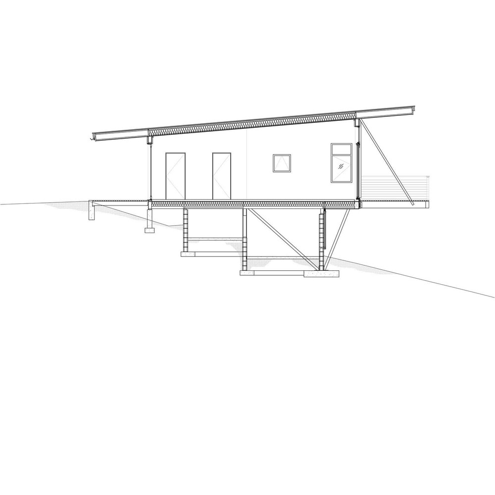 """Location: Methow Valley, WA  Size: 850 sf    In order to meet the client's budget goals, an efficient plan and cost effective selection of building materials reduced construction costs and led to the simple box design. The use of sheet materials both inside and out maximized material efficiency while emphasizing the simplicity of the cabin's form. Two concrete walls cradle the box and allow it to cantilever over the hillside, reducing effective site disturbance. Elevating the cabin allowed for unobstructed views down slope and to the mountains beyond, transforming a modest living space from ordinary room to a viewing platform that extends from inside to out.  We believe this project demonstrates our belief that architecturally interesting solutions can be achieved for budgets of all sizes without sacrificing quality or aesthetics.    Awards and Recognition:  Sunset Magazine, December 2009, """"The Great Escape"""" p. 42-45"""