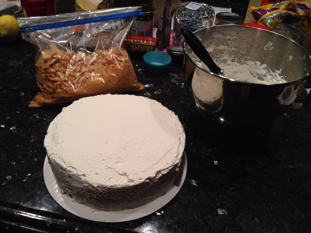And the last step, once your cake is covered, is to cover it with the crunch right before you serve it.