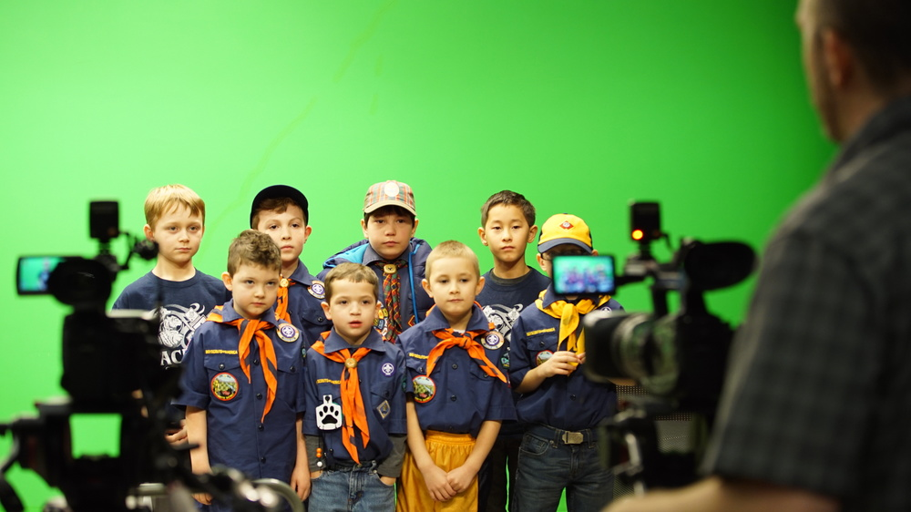 A group of boys scouts record a PSA in CCTV's studios.