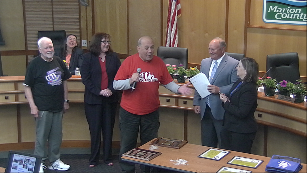 Marion County Commissioners Sam Brentano and Janet Carlson recognize CCTV Volunteers Ed Freydl and Joe Fabbri.