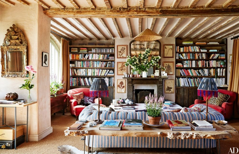 Tons of book, a fireplace, a chesterfield sofa and tons of windows to let view of the rolling hills in...  Note to self: the ticking fabric on chesterfield sofa paired with leopard print pillow on red armchairs looks heavenly together. Stripes and animals pattern do work.
