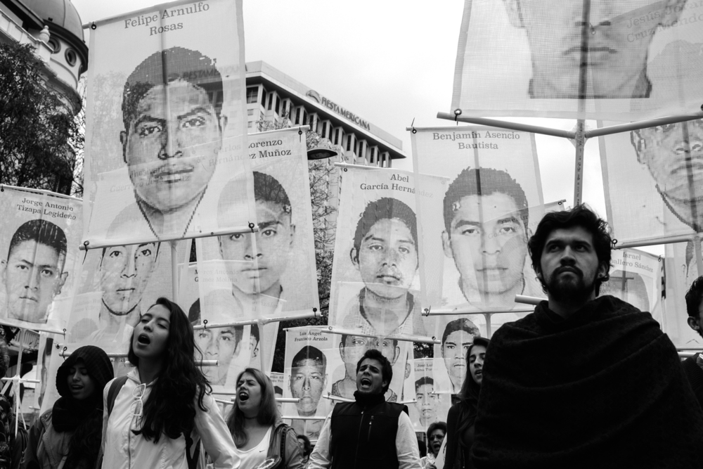 """  They were taken alive, we want them back alive'' protesters chanted during a demonstration in Mexico City for 43 students who were disappeared from Guerrero last September. PHOTO CREDIT: MEGHAN DHALIWAL"