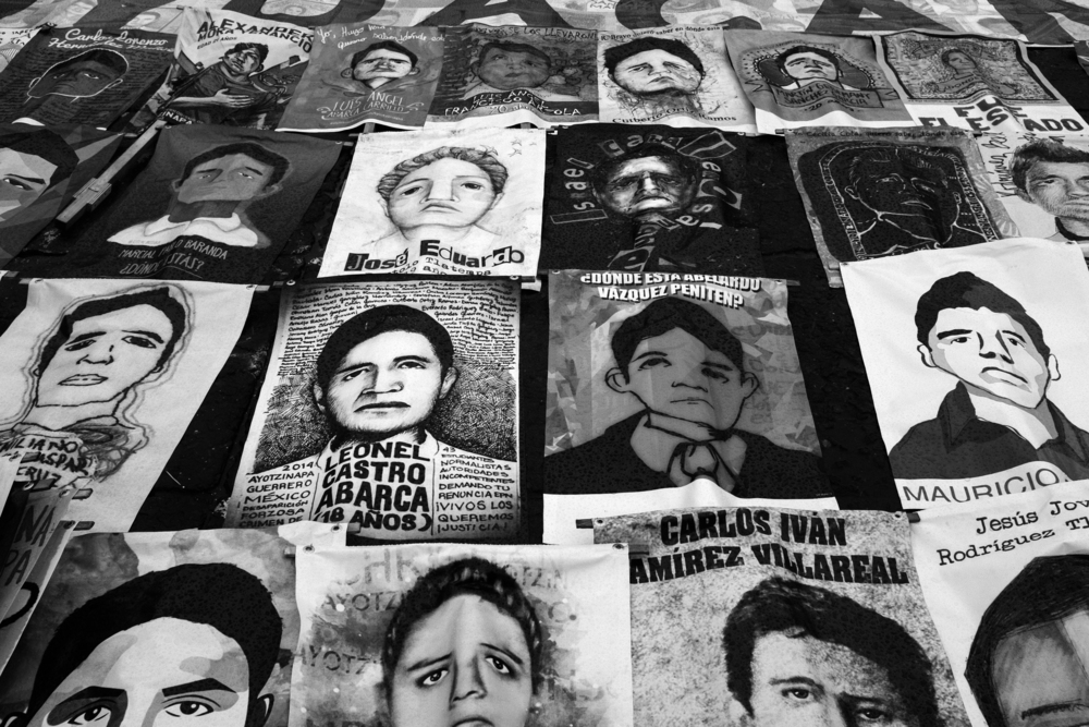 Protesters carried images of each of the 43 teaching students last at a demonstration in Mexico City, Mexico that marked the one-year anniversary of their disappearance. PHOTO CREDIT: MEGHAN DHALIWAL.