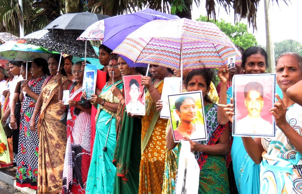 FAMILIES OF MISSING TAMIL PEOPLE IN THE JAFFNA, SRI LANKA STAGED A PROTEST IN DECEMBER 2015 TO EXPRESS THEIR DISAPPOINTMENT WITH A PRESIDENTIAL COMMISSION ON DISAPPEARANCES IN THE COUNTRY. IMAGE COURTESY OF TAMIL GUARDIAN.