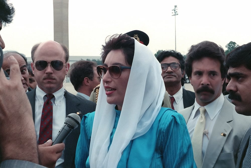 Benazir Bhutto, the Prime Minister of Pakistan, speaks to the press upon her arrival for a state visit at Andrews Air Force Base. photo by gerald b, johnson via wikimedia commons.