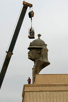 IRAQI CONTRACTORS PREPARE TO REMOVE A STATUE OF SADDAM HUSSEIN'S HEAD FROM THE PRESIDENTIAL PALACE IN BAGHDAD, IRAQ ON DEC. 2, 2003. PHOTO BY PHOTO BY TECH. SGT. JOHN HOUGHTON VIA WIKIMEDIA COMMONS.