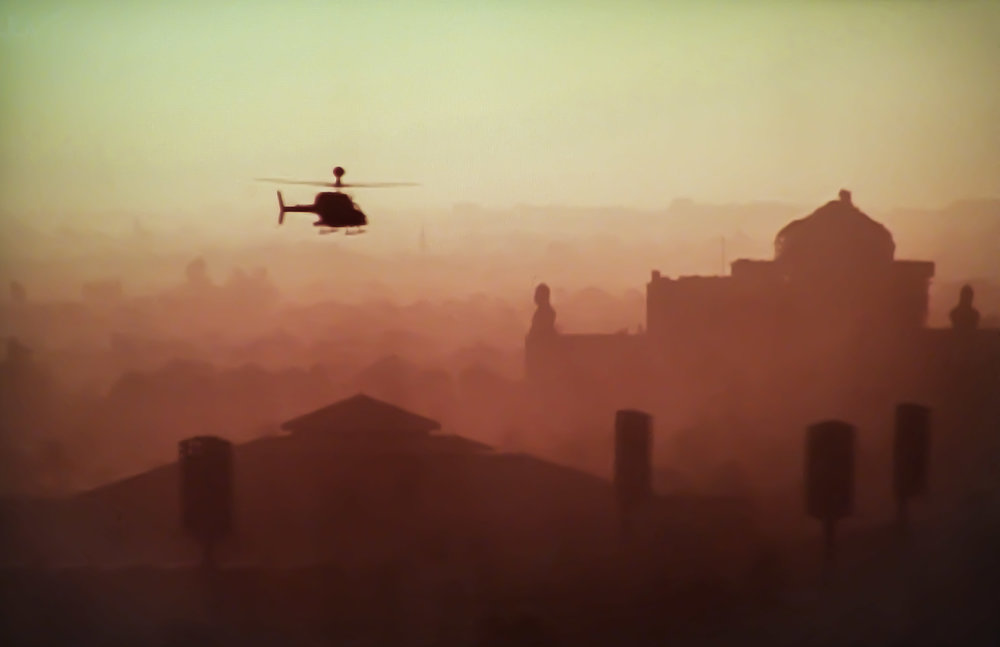 A SURVEILLANCE HELICOPTER FLIES OVER BAGHDAD. PHOTO BY RLD73 VIA FLICKR.
