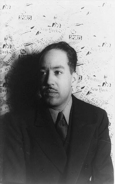 LANGSTON HUGHES SITS FOR A PORTRAIT BY CARL VAN VECHTEN IN 1936. IMAGE VIA WIKIMEDIA COMMONS.