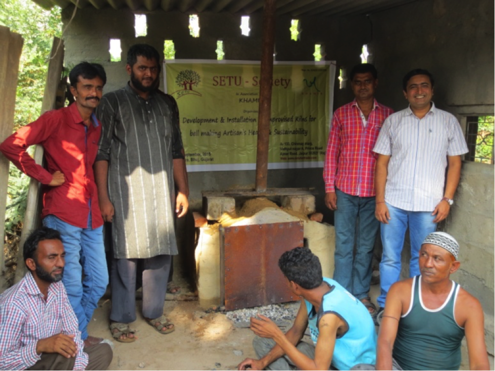 SETU team lead Devendra Dhariwal (far right) and Bell Craft artisans next to a kiln with an improved exhaust system
