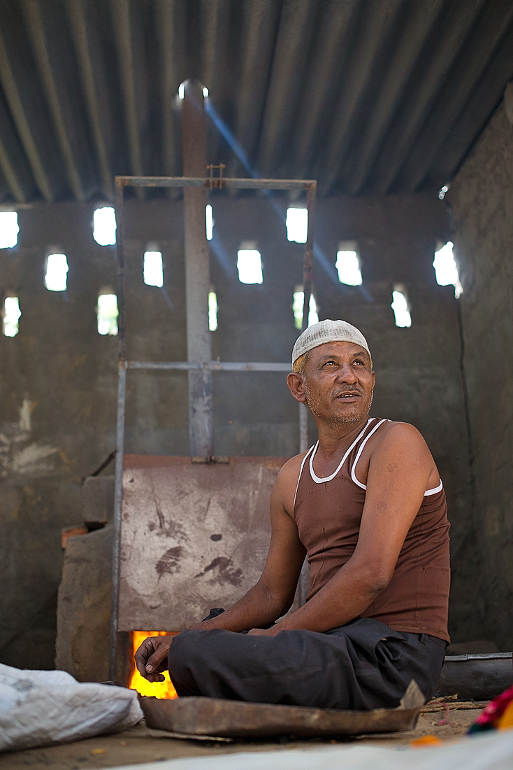 Bachhu, a master artisan, works with a new new kiln with door