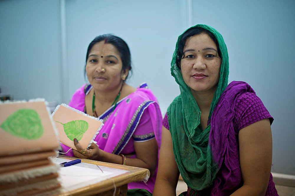 Women artisans handcrafting cotton paper journals in North West India.