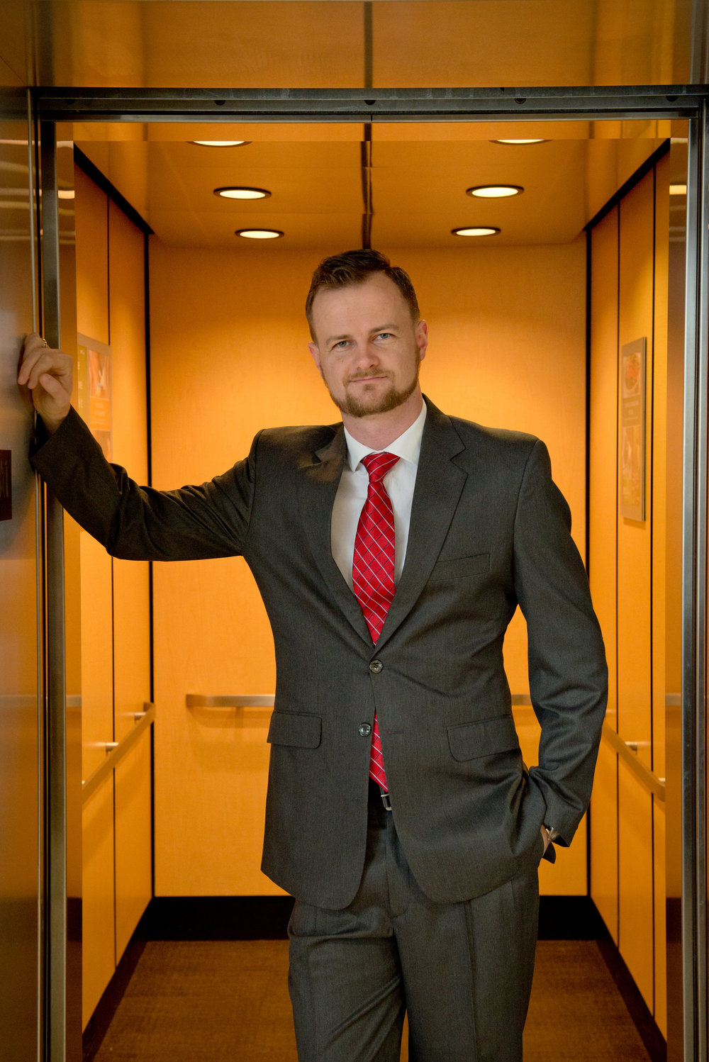Orlando-senior-guy-elevator-suit.jpg