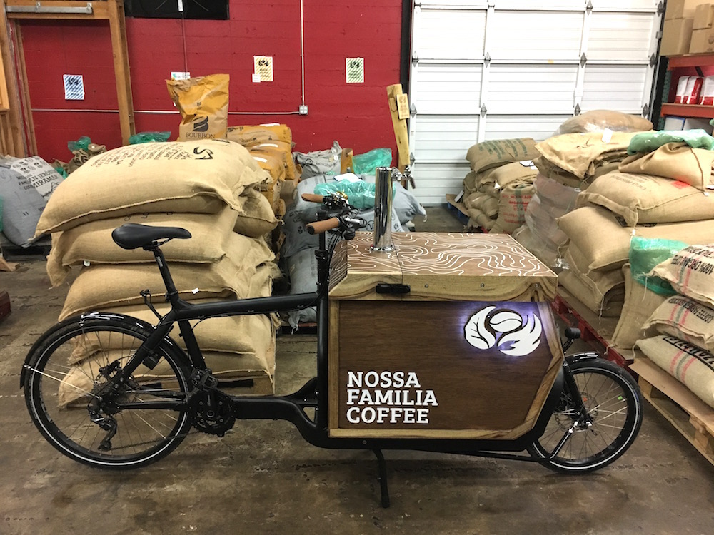 Nossa Familia Coffee's New Iced Coffee Cargo Bike with kegs on tap