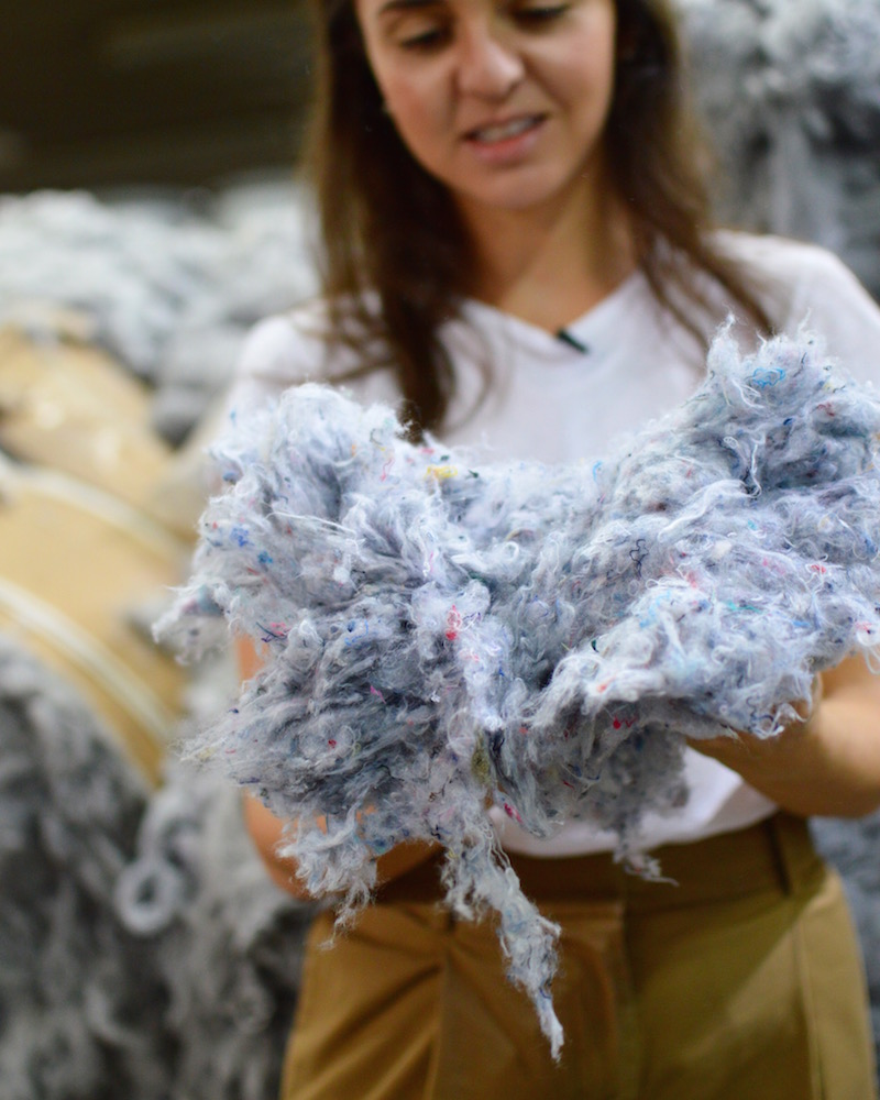 Arianne Engelberg from The New Denim Project holds textile fibers used to make upcycled fabrics