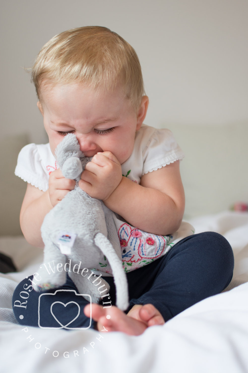 This teething baby can't get that soft toy into her mouth quickly enough!  Not a 'perfect' photo, but one that is a reminder of a particular time (plus, it's funny!).