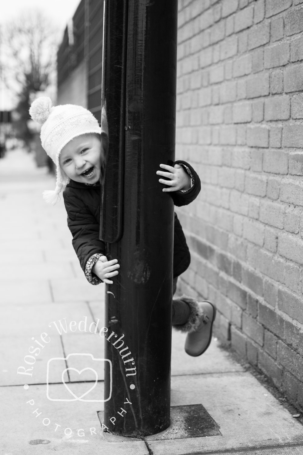 Always have your camera ready in advance so you don't miss spontaneous moments like this gorgeous girl swinging around a lamppost with a cheeky smile!