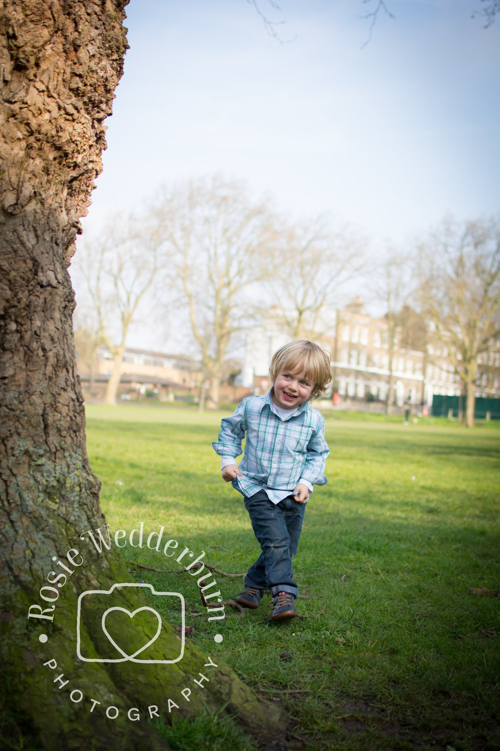The moment he spied his dad, hiding behind a tree produced a sweet, joyful smile!