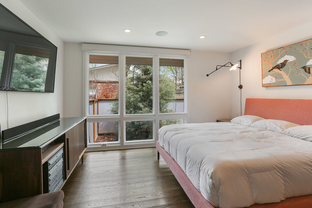 Floor to ceiling, industrial style windows allow lots of natural light to fill each room.