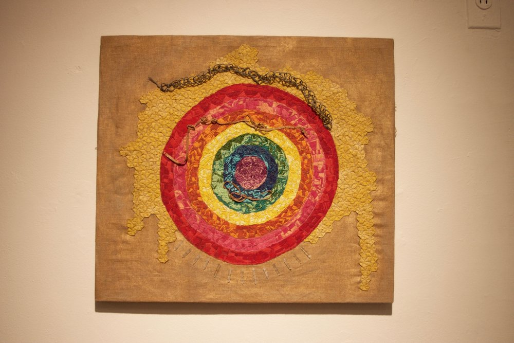 The Rainbow Circle , embroidery on linen with paint, wire, leather, and quartz crystals, 22 x 20 inches