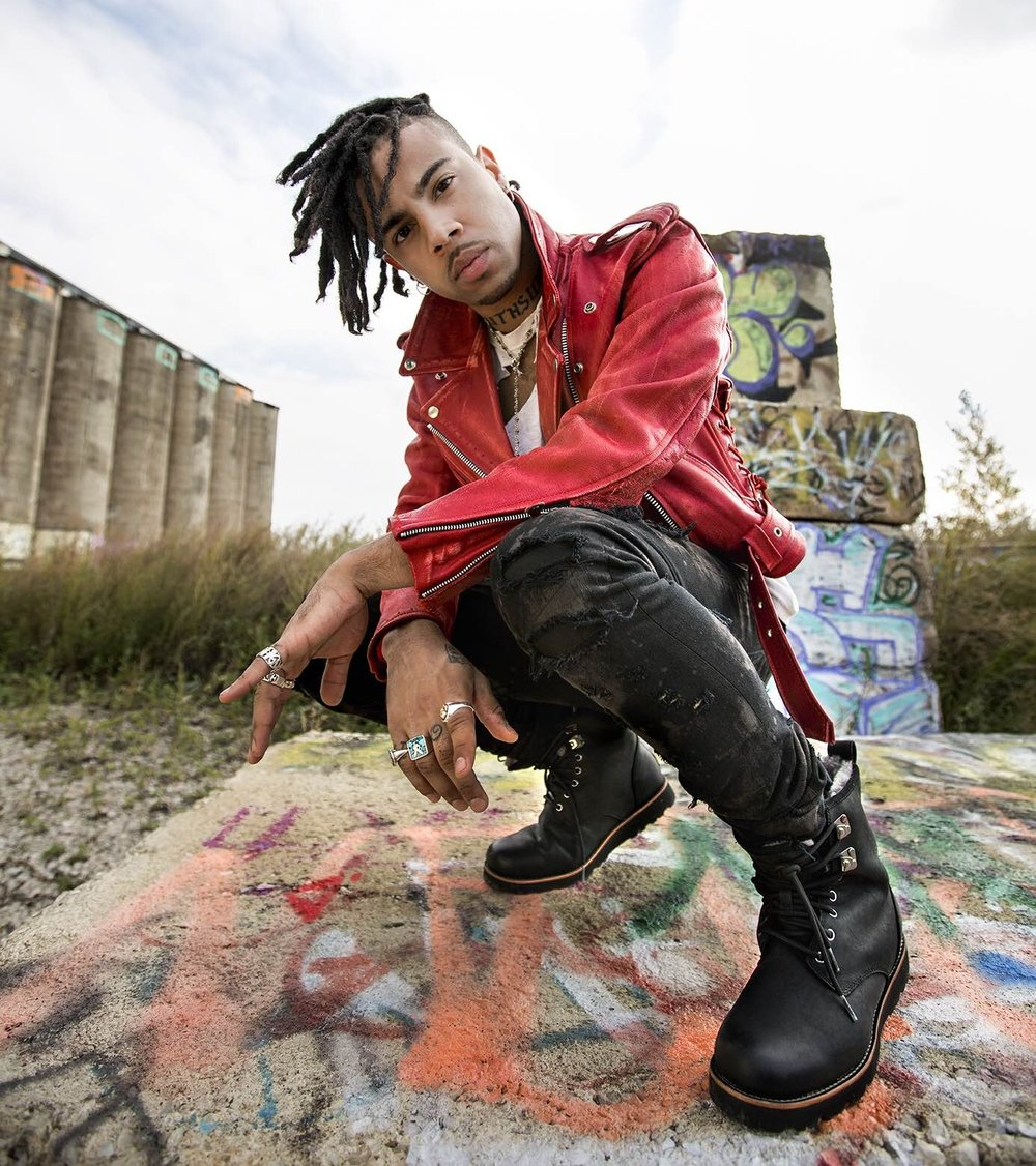"""Vic Mensa - Chicago rapper Vic Mensa released his debut mixtape Innanetape in 2013 and closed out the year by joining J. Cole and Wale on the """"What Dreams May Come True"""" Tour. The critically acclaimed project earned him a top spot on XXL Magazine's 2014 Freshman Class. Mensa was featured on Kanye West's song """"Wolves,"""" and earned a Grammy Nomination as a songwriter on West's song """"All Day,"""" from his album The Life of Pablo. In 2016, Mensa released his 7-track debut EP, There's Alot Going On, which included the powerful song """"16 Shots."""" Mensa has collaborated with West on the hit single """"U Mad,"""" Kaytranada's """"DRIVE ME CRAZY"""" and Gorillaz song """"Clint Eastwood."""" He has performed at Governors Ball Festival 2015 Coachella Music Festival, Lollapalooza and many more."""