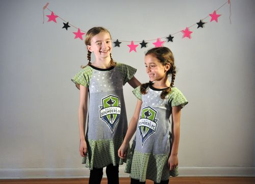 Upcycling at it's best...these dresses were made from Sounders tee shirts and a thrifted couch slip cover!