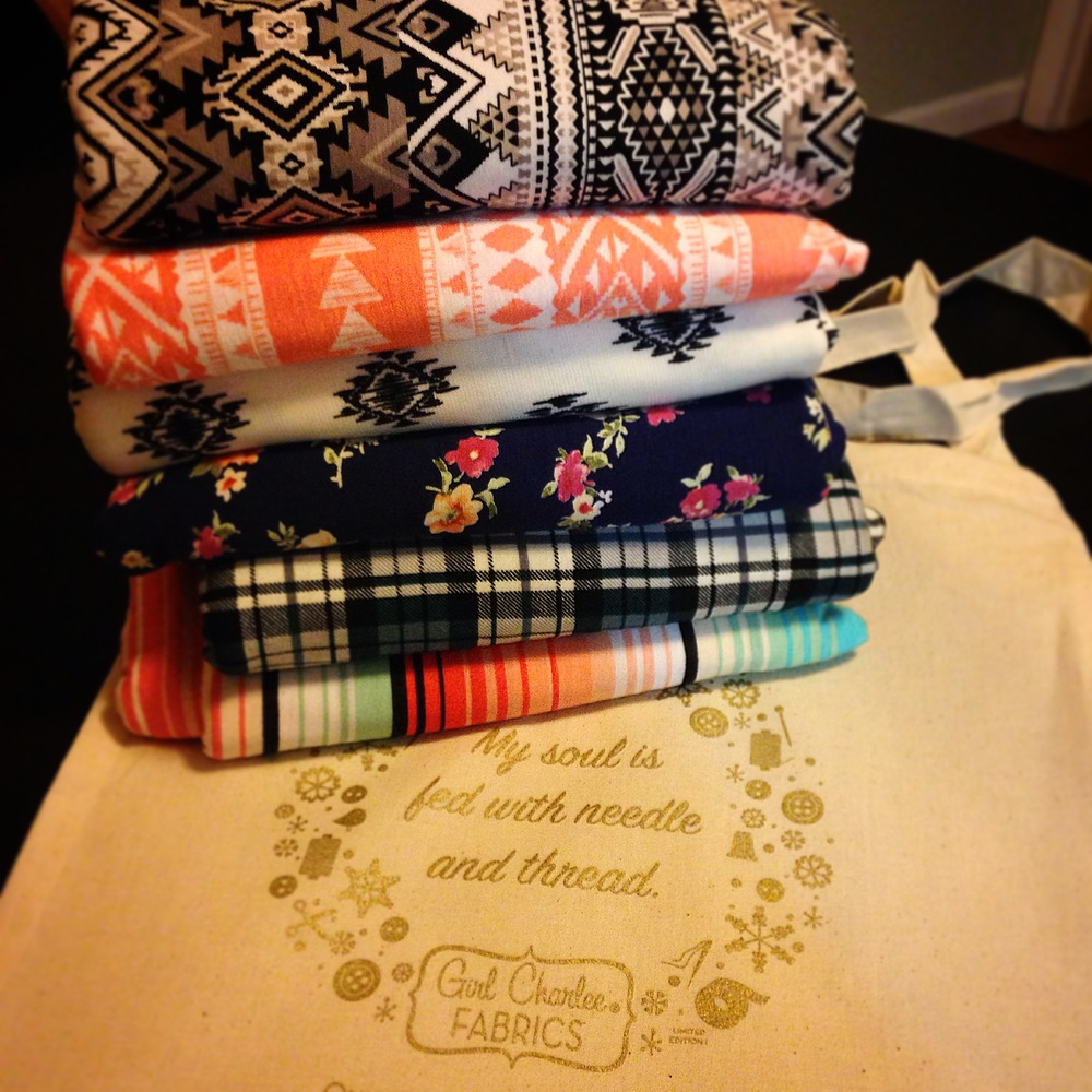 I got my first  Girl Charlee Knit Fix bag  the the other day!  Once a month you can order it and it is filled with surprise fabrics!  Two yards of each...and I love everything I got!