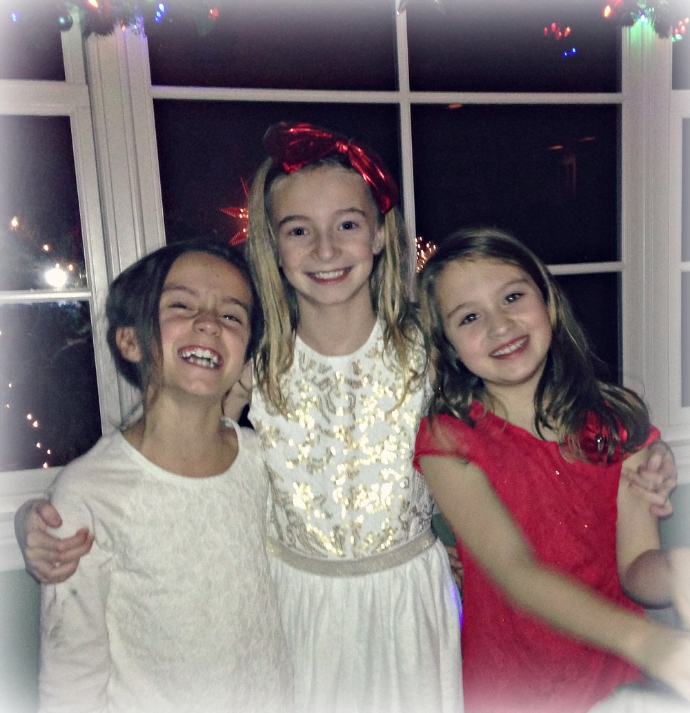 "And finally...Parker and her two besties at a recent holiday party.   They are probably what you would call ""forced besties"" because their families and ours are such good friends so they have been forced to hang out since they were babies...but thankfully these girlies clicked and they love one another so much!  They melt my heart!"