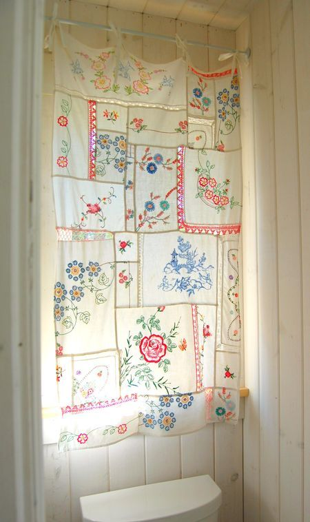And lastly, how about something for my home?  I'm in love with this curtain.  I need to start collecting little hankies like these so I can make my own!  from here