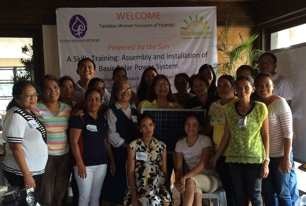 FWN Founder & CEO Marily Mondejar (center in yellow) at a solar powered systems job skills training in Tacloban, February 2014. To view more photos, visit    http://photos.filipinawomensnetwork.org